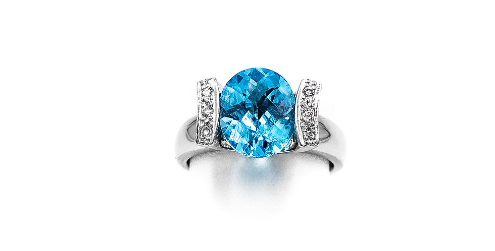 White Gold Oval Blue Topaz In Tension Setting Pave Sides