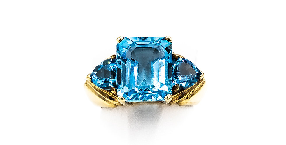 Yellow Gold Emerald Shape Blue Topaz One Trillion Ring