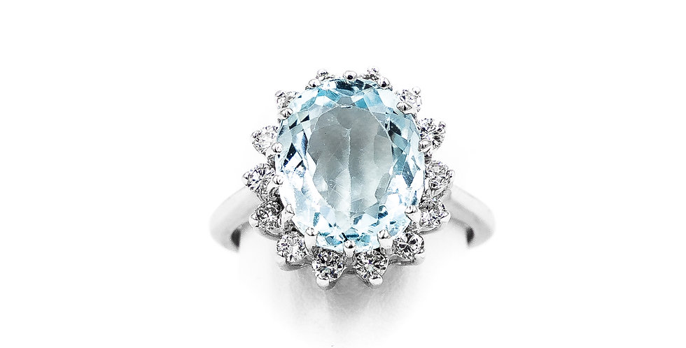 White Gold Oval Aqua Set In Halo Ring