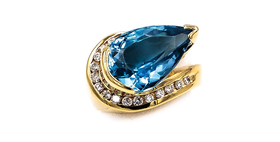 Yellow Gold Pear Shape Blue Topaz With Channel Stones Ring