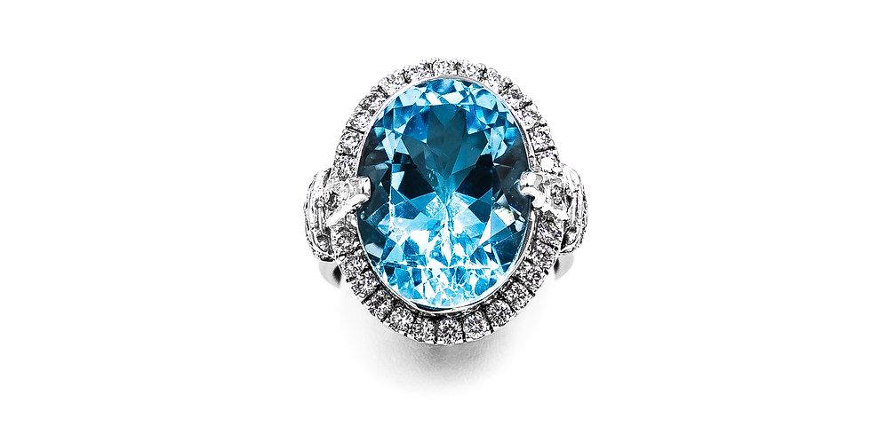 White Gold Oval Blue Topaz Set In Diamond Halo Ring