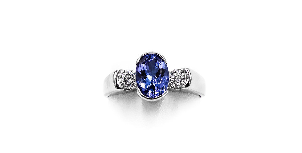 White Gold Oval Tanzanite With One Road Stone Ring