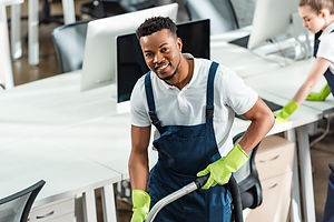 smiling african american cleaner looking