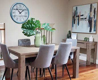 Ambient Dining Room with plenty of natural light creates a space that is welcoming. Comfortable dining chairs encourage your guests to Sit, Eat and Relax