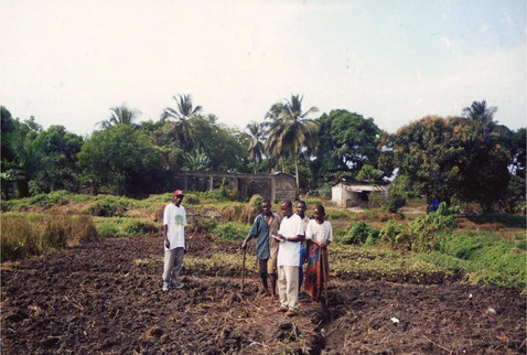 The First Fhth's Agricultural Pragram Session In Liberia, Was Conducted By Mr. Vamba F. Kanneh, Standing At The Left In The Photos.