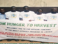 HOLDING THE FHTH'S BANNER, THIRD FROM RIGHT IS MR. VAMBER F. KANNEH, FHTH'S FIRST EXECUTIVE DIRECTOR OF LIBERIA.