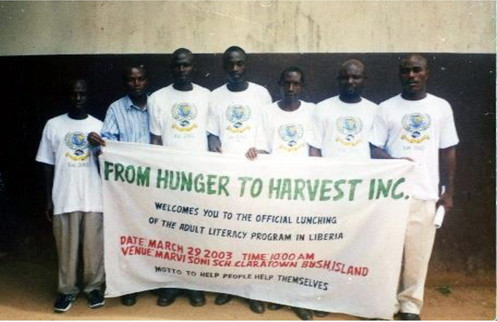 Holding the FHTH's banner, third from right is mr. Vamber f. Kanneh, fhth's first executive director of liberia