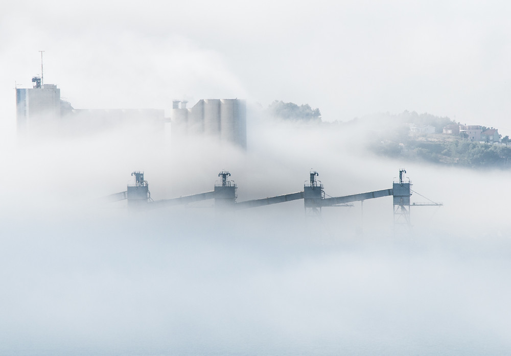 Smog in a city Climate change from Photo by Carolina Pimenta on Unsplash
