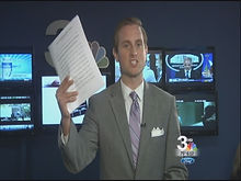 Greg Gullberg holding documents obtained via public records request