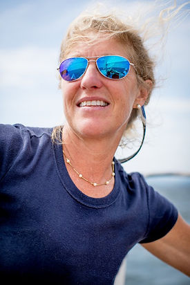 Background image of Sail Beyond Cancer's founder, Suzanne.