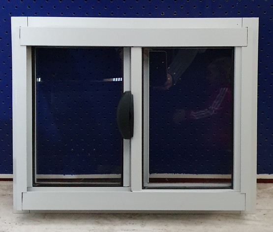 small white laundry sliding window