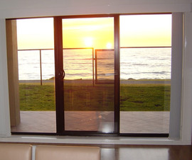 Henley Beach ClearShield sliding doors at sunset