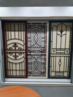 Multiple cast panel doors and screens on display at Aluminium Plus, located at 18 Acrylon Road Salisbury South
