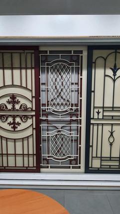 Multiple cast panel doors and screens on display at Aluminium Plus, located at 18 Acrylon Road Salisbury South