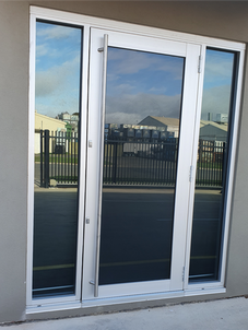 Salisbury South Commercial hinged door with fixed panels either side
