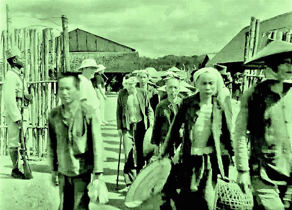 Asian prisoners leaving their compound f