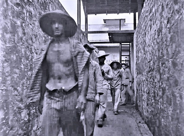 Prisoners exiting the cell block on Devi