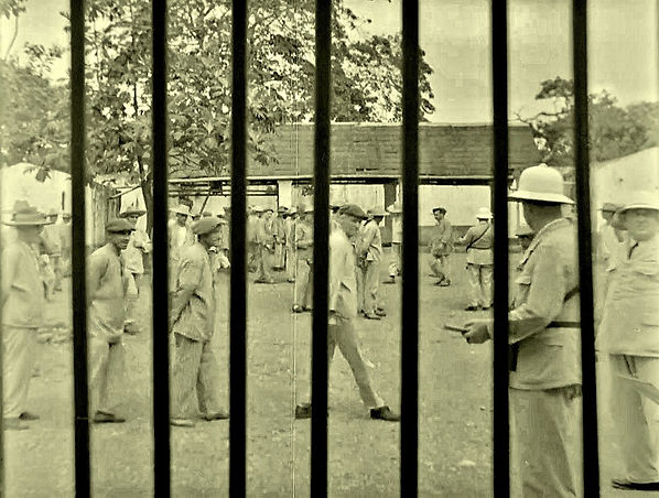 View of a yard with prisoners and guards