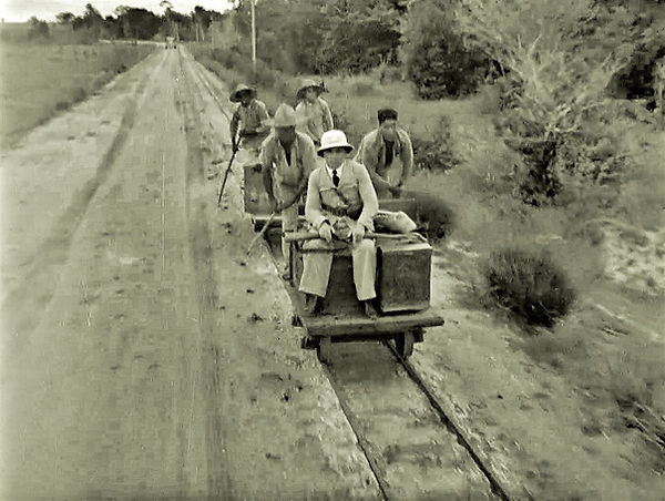 Armed guard riding on rail push carts Fr