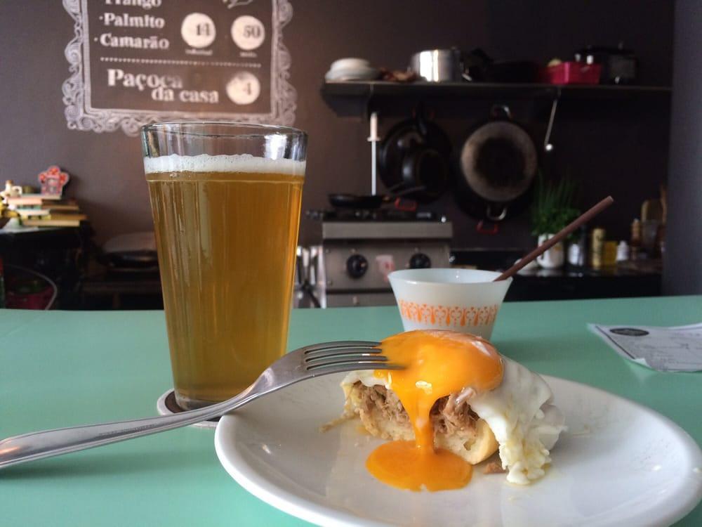 Coruja beer and pão de queijo filled with slow-cooked ham at Conceição Discos