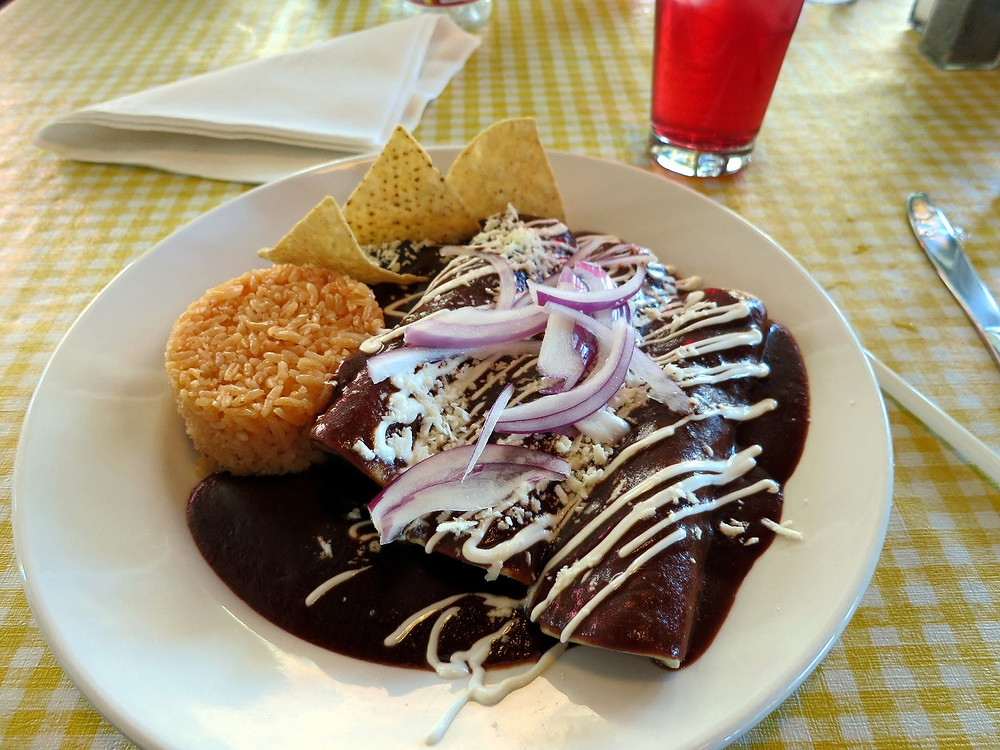Enchilladas topped with mole sauce, photo: Ruth and Dave via Visual hunt / CC BY