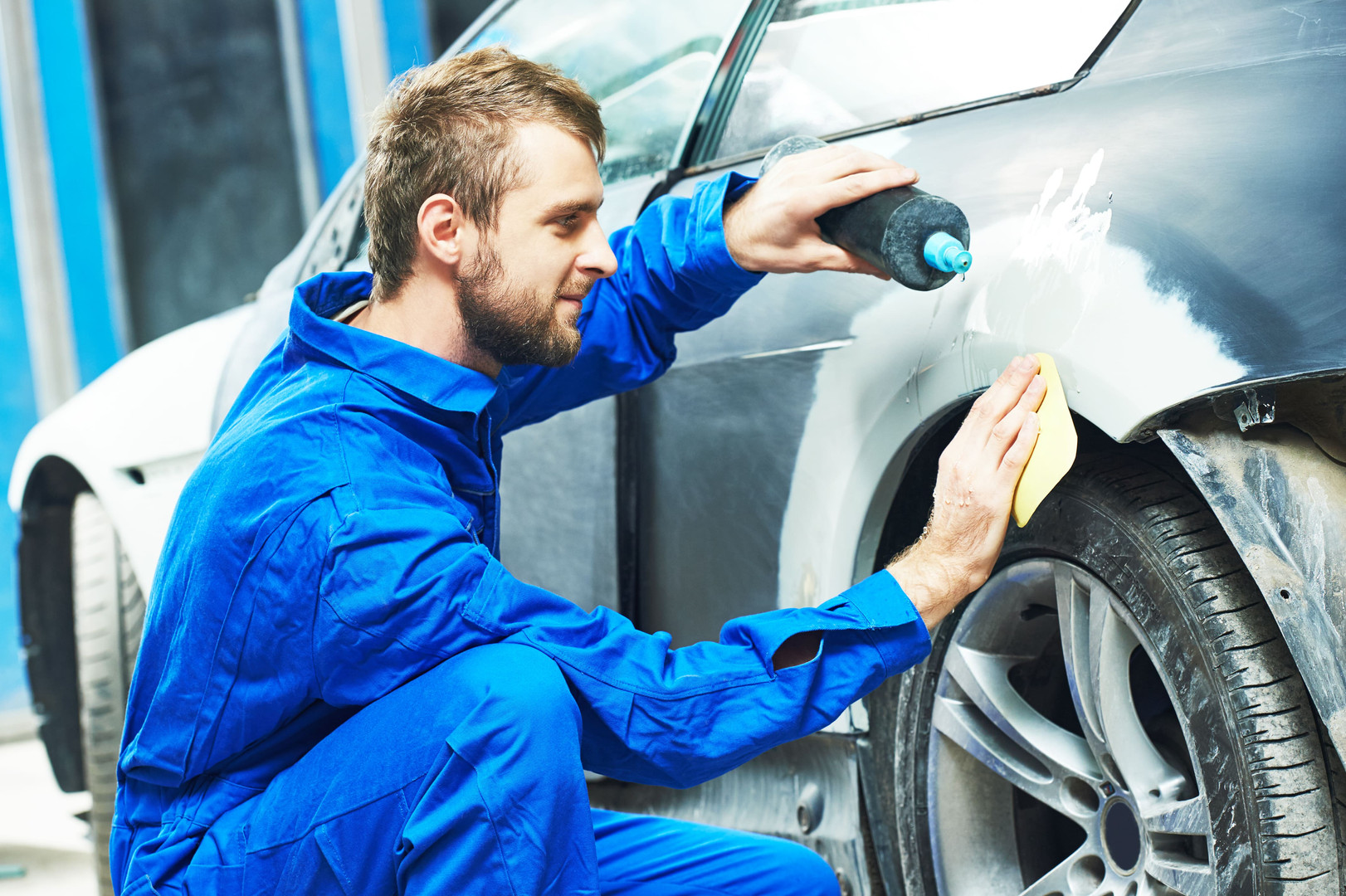 Collision Experts auto mechanic worker a