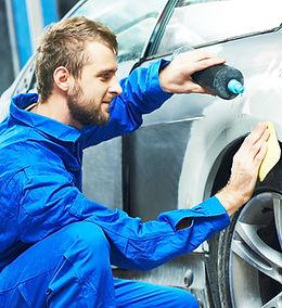 auto mechanic worker applying washing ca