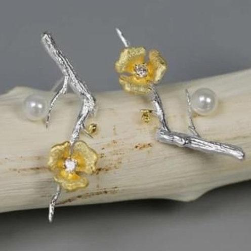 Boucles d'oreilles fleur dorée