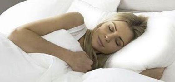 beautiful lady laying on a silk pillowcase