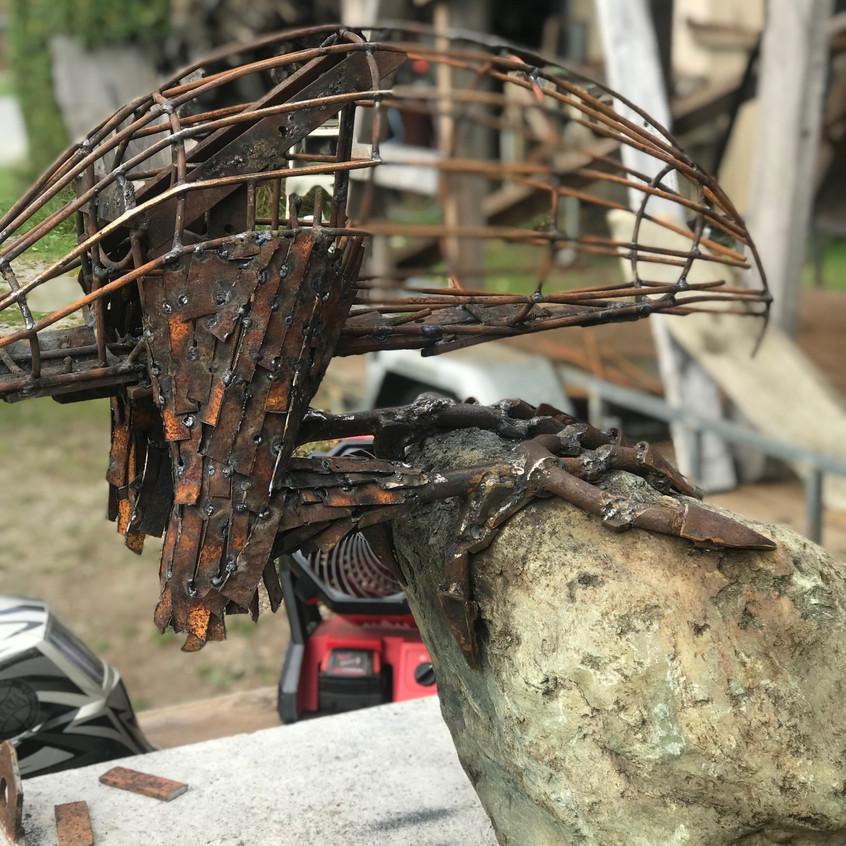 Dan Kelly Sculpture - NZ Falcon on rock for STONEFLY Lodge Motueka