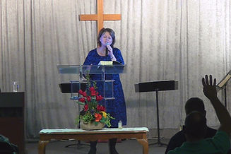 Pastor Theresa Beall singing praise and worship