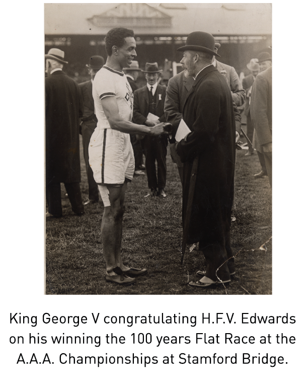 King George V congratulating H.F.V. Edwards on his winning the 100 years Flat Race at the A.A.A. Championships at Stamford Bridge.