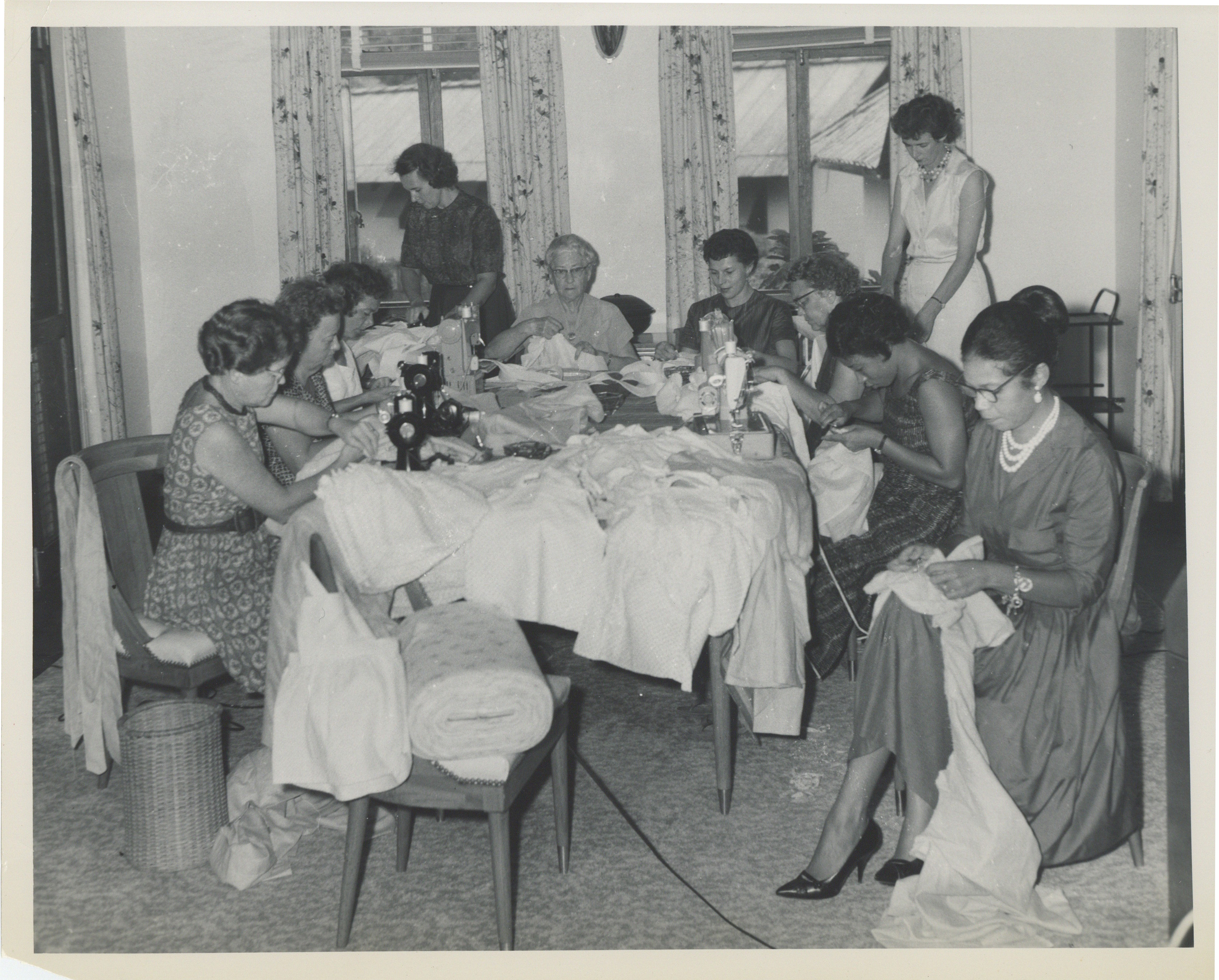 Bonita Valien n Nigeria organizing women sewing for hospital group Bonita organized in 1960