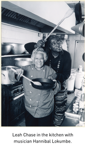Leah Chase in the kitchen with musician Hannibal Lokumbe.