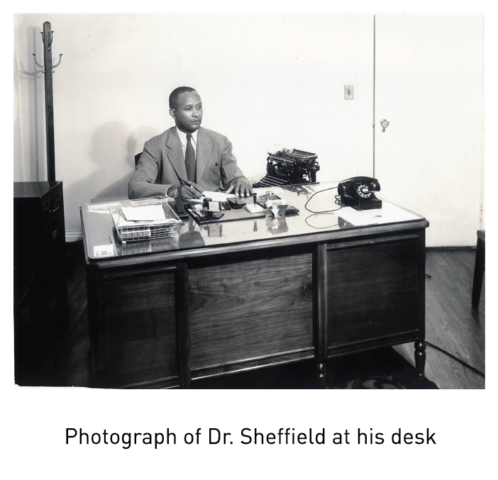 Photograph of Dr. Sheffield at his desk