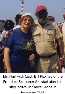 Ms. Hart with Capt. Bill Pickney of the Freedom Schooner Amistad after the ship' arrival in Sierra Leone in December 2007.