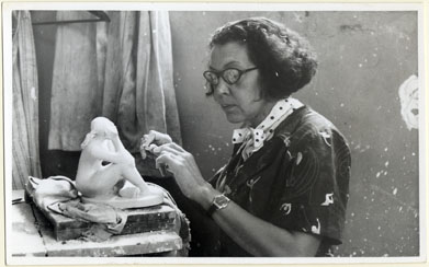 Elizabeth Catlett at work in her studio, circa 1950s