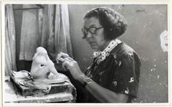 Elizabeth Catlett at work in her studio, circa 1950s