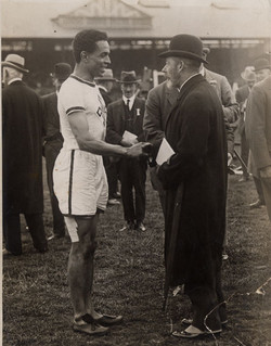 British track and field athlete Harry F.V. Edward being congratulated by King George V prior to Edwa