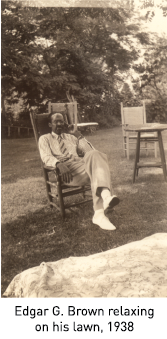 Edgar G. Brown relaxing on his lawn, 1938