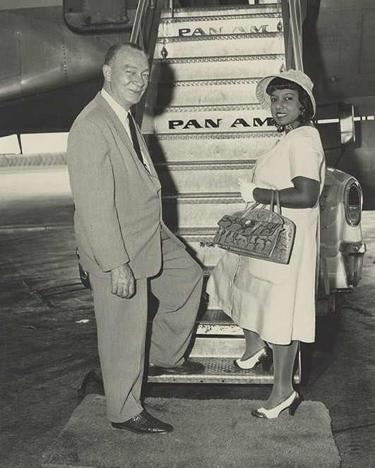 Dr. Marguerite Cartwright and her husband Leonard Carl Cartwright boarding a Pan Am flight.