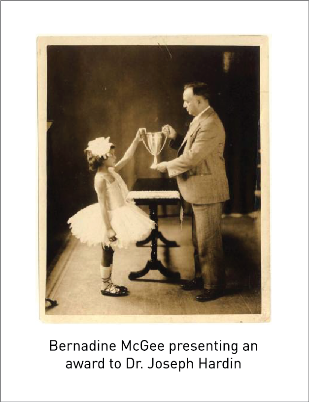 Bernadine McGee presenting an award to Dr. Joseph Hardin