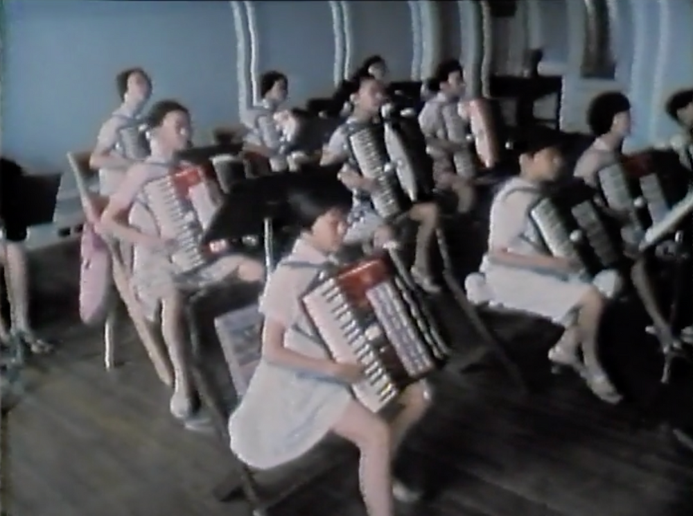 """Chinese accordion students perform """"Home on the Range"""" for the U.S. delegation from Kansas."""