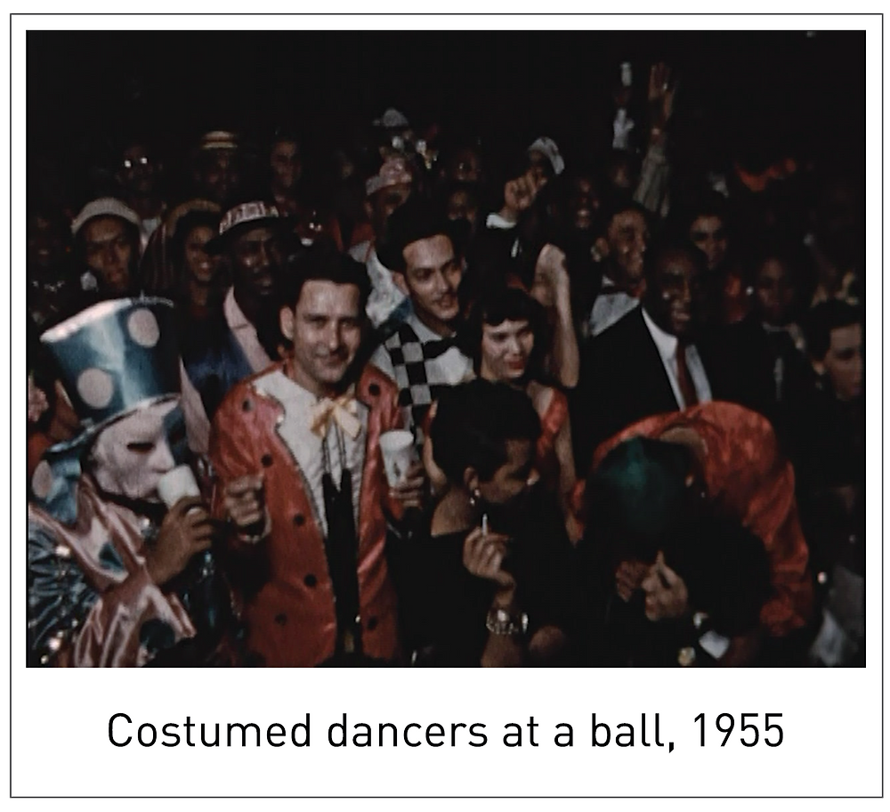 Costumed dancers at a ball, 1955