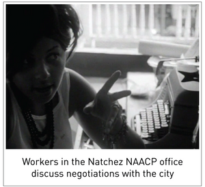 Workers in the Natchez NAACP office discuss negotiations with the city