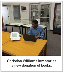 Christian Williams inventories a new donation of books.