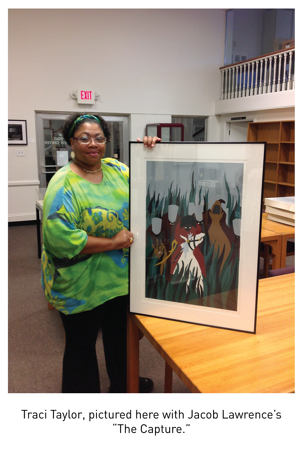 """Traci Taylor, pictured here with Jacob Lawrence's """"The Capture."""""""