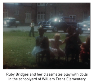 Ruby Bridges and her classmates play with dolls in the schoolyard of William Franz Elementary