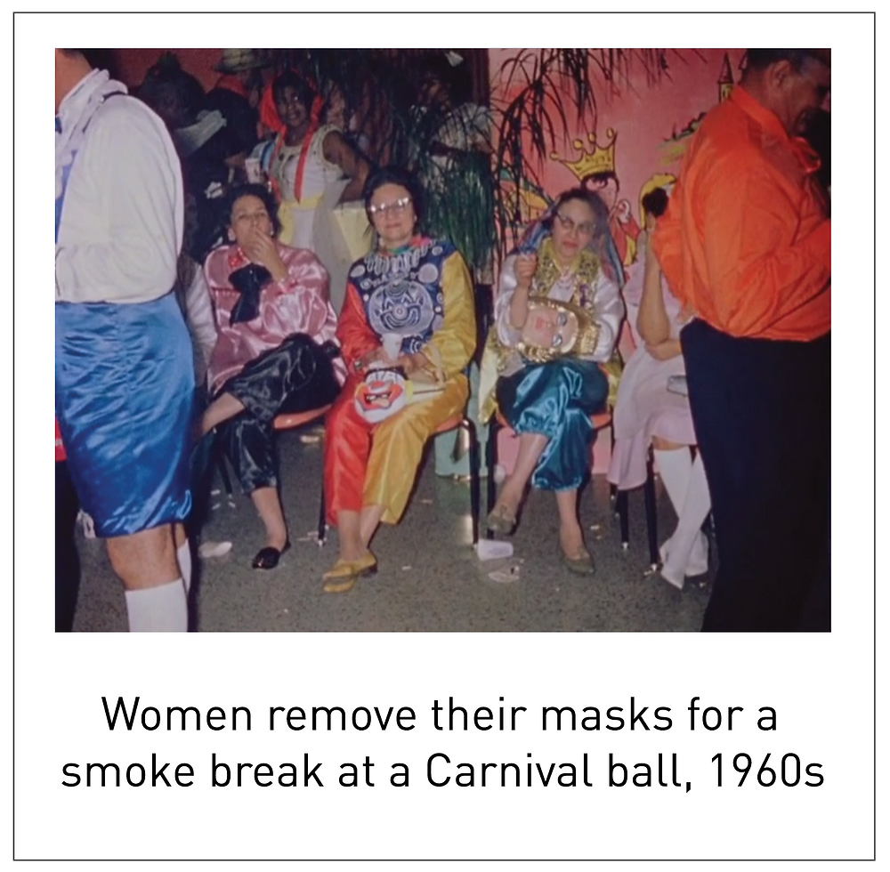 Women remove their masks for a smoke break at a Carnival ball, 1960s