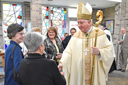 Bishop greets processor